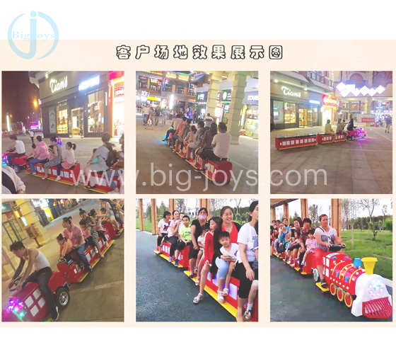 Children sit on electric train